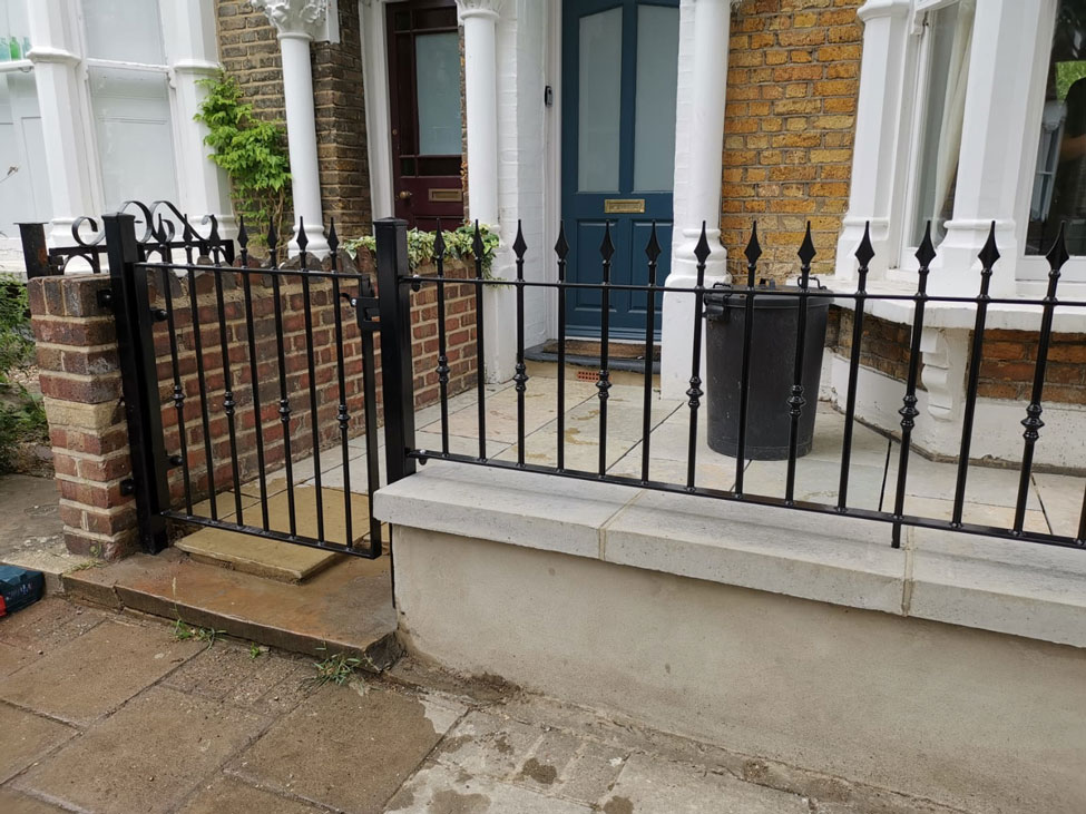 wrought iron railings and gate
